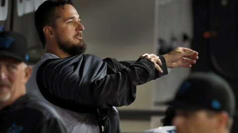 <p>               Miami Marlins starting pitcher Caleb Smith puts on his jacket in the dugout after losing a perfect game and no hitter during the sixth inning of a baseball game against the Chicago White Sox Tuesday, July 23, 2019, in Chicago. (AP Photo/Charles Rex Arbogast)             </p>