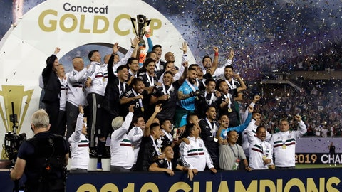 <p>               Mexico players celebrate with the trophy after Mexico defeated United States 1-0 in the CONCACAF Gold Cup final soccer match  in Chicago, Sunday, July 7, 2019. (AP Photo/Nam Y. Huh)             </p>