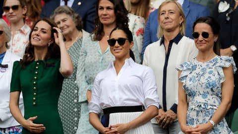 <p>               Kate, Duchess of Cambridge, Meghan, Duchess of Sussex and Pippa Matthews, foreground from left to right, stand together during the women's singles final match on day twelve of the Wimbledon Tennis Championships in London, Saturday, July 13, 2019. (AP Photo/Ben Curtis)             </p>