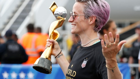 <p>               United States women's soccer team member Megan Rapinoe holds the Women's World Cup trophy as she poses for the media after arriving with the rest of the team at Newark Liberty International Airport, Monday, July 8, 2019, in Newark, N.J. (AP Photo/Kathy Willens)             </p>