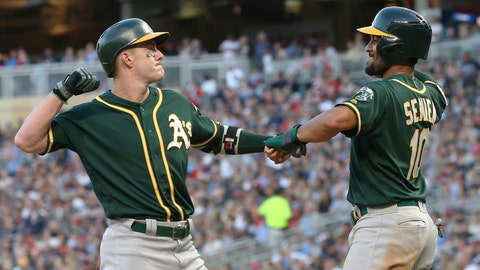 <p>               Oakland Athletics' Mark Canha, left, and Marcus Semien celebrate Canha's two-run home run off Minnesota Twins pitcher Zack Littell in the seventh inning of a baseball game Saturday, July 20, 2019, in Minneapolis. The Athletics won 5-4. (AP Photo/Jim Mone)             </p>