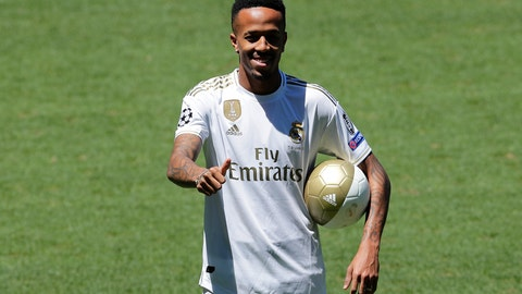 <p>               Eder Militao poses in his new strip during his official presentation after signing for Real Madrid at the Santiago Bernabeu stadium in Madrid, Spain, Wednesday, July 10, 2019. (AP Photo/Manu Fernandez)             </p>