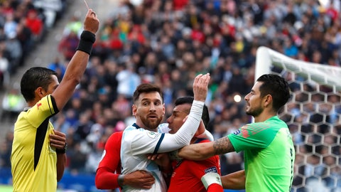 <p>               Argentina's Lionel Messi, center left, and Chile's Gary Medel, center right, scuffle as referee Mario Diaz, from Paraguay, left, shows the red card to both of them during Copa America third-place soccer match at the Arena Corinthians in Sao Paulo, Brazil, Saturday, July 6, 2019. (AP Photo/Victor R. Caivano)             </p>
