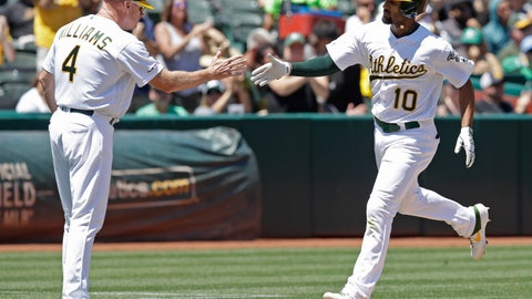 <p>               Oakland Athletics' Marcus Semien, right, is congratulated by third base coach Matt Williams (4) after hitting a home run off Texas Rangers pitcher Pedro Payano in the third inning of a baseball game Sunday, July 28, 2019, in Oakland, Calif. (AP Photo/Ben Margot)             </p>