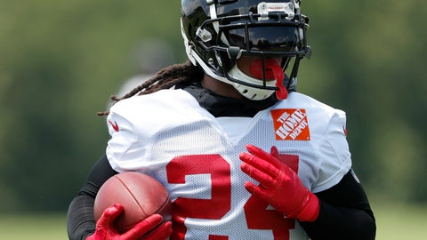 """<p>               FILE - In this Tuesday, June 11, 2019, file photo, Atlanta Falcons running back Devonta Freeman (24) runs during an NFL football practice in Flowery Branch, Ga.  When Atlanta Falcons coach Dan Quinn calls running back Devonta Freeman a """"multiplier"""" he is talking about Freeman making every other player on the offense better. That makes Freeman's health an obvious key after he was limited by injuries to two games in 2018. (AP Photo/John Bazemore, File)             </p>"""