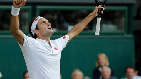 <p>               Switzerland's Roger Federer celebrates defeating Spain's Rafael Nadal during a men's singles semifinal match on day eleven of the Wimbledon Tennis Championships in London, Friday, July 12, 2019. (AP Photo/Ben Curtis)             </p>