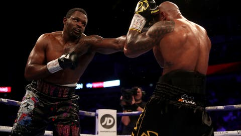 <p>               Dillian Whyte, left, in action against Oscar Rivas, right, in the WBC interim Heavyweight title fight at the O2 Arena in London, Saturday, July 20, 2019. (Bradley Collyer/PA via AP)             </p>