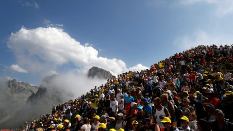 <p>               Spectators stand on the Tourmalet pass next to the finish line of the fourteenth stage of the Tour de France cycling race over 117.5 kilometers (73 miles) with a start in Tarbes and finish at the Tourmalet pass, France, Saturday, July 20, 2019. (AP Photo/ Christophe Ena)             </p>