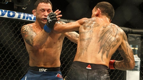 <p>               Max Holloway, right, punches Frankie Edgar during a mixed martial arts bout at UFC 240, in Edmonton, Alberta, Saturday, July 27, 2019. (Jason Franson/The Canadian Press via AP)             </p>