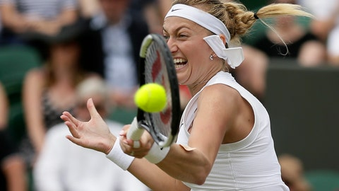 <p>               Czech Republic's Petra Kvitova returns to Polands's Magda Linette in a Women's singles match during day six of the Wimbledon Tennis Championships in London, Saturday, July 6, 2019. (AP Photo/Tim Ireland)             </p>