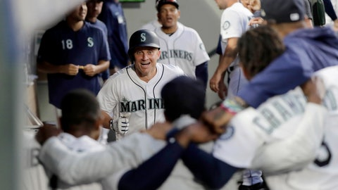 <p>               Teammates stand arm-in-arm as they wait to celebrate with Seattle Mariners' Kyle Seager, center, after Seager hit a solo home run against the Detroit Tigers during the fifth inning of a baseball game, Thursday, July 25, 2019, in Seattle. (AP Photo/Ted S. Warren)             </p>