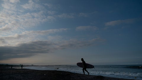 <p>               In this Wednesday, July 17, 2019, photo, a surfer walks out of the ocean at Taito Beach located next to Tsurigasaki, a venue for surfing at the Tokyo 2020 Olympics, in Isumi, Chiba prefecture, east of Tokyo. As one of five new sports being added to the program for 2020 Tokyo Olympics, surfing is arguably the most glamorous and is sure to bring a new dimension as the IOC seeks a younger audience. (AP Photo/Jae C. Hong)             </p>