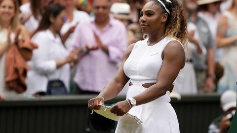 <p>               United States' Serena Williams holds her second place trophy after losing to Romania's Simona Halep in the women's singles final match on day twelve of the Wimbledon Tennis Championships in London, Saturday, July 13, 2019. Halep defected Williams 6-2/6-2. (AP Photo/Tim Ireland)             </p>