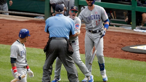 <p>               Chicago Cubs manager Joe Maddon, center, yells toward the Pittsburgh Pirates dugout as he is restrained by umpire Joe West and Cubs' Kris Bryant (17) during the fourth inning of a baseball game in Pittsburgh, Thursday, July 4, 2019. Maddon was ejected. (AP Photo/Gene J. Puskar)             </p>