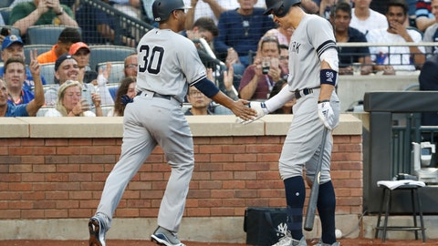 <p>               New York Yankees' on-deck batter Aaron Judge, right, congratulates New York Yankees' Edwin Encarnacion (30) after Encarnacion scored on James Paxton's sacrifice bunt during the second inning of an interleague baseball game against the New York Mets, Tuesday, July 2, 2019, in New York. (AP Photo/Kathy Willens)             </p>