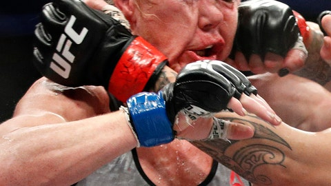<p>               FILE - In this Dec. 30, 2017, file photo, Holly Holm gets hit in the face by Cris Cyborg, obscured at right, during a featherweight championship mixed martial arts bout at UFC 219 in Las Vegas. Holly Holm just can't stay away from the toughest challenges in her sports. The boxer-turned-mixed martial artist who has endured plenty of setbacks since she shocked Ronda Rousey will attempt to knock off dominant two-division champion Amanda Nunes on Saturday, July 6, 2019. (AP Photo/John Locher, File)             </p>