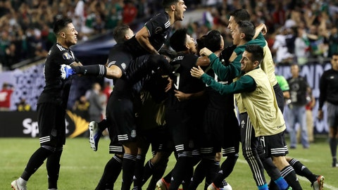 <p>               Mexico midfielder Jonathan Dos Santos (6) celebrates with teammates after scoring his first goal against the United States during the second half of the CONCACAF Gold Cup final soccer match in Chicago, Sunday, July 7, 2019. (AP Photo/Nam Y. Huh)             </p>