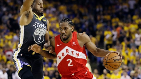 <p>               FILE - In this June 13, 2019, file photo, Toronto Raptors forward Kawhi Leonard (2) drives against Golden State Warriors forward Andre Iguodala (9) during the first half of Game 6 of basketball's NBA Finals in Oakland, Calif. A person familiar with the negotiations says the Los Angeles Clippers will be landing Kawhi Leonard as a free agent after they acquire Paul George from the Oklahoma City Thunder in a massive trade for players and draft picks. (AP Photo/Ben Margot, File)             </p>