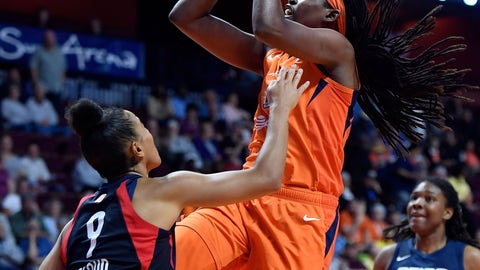 <p>               FILE - In this June 11, 2019, file photo, Connecticut Sun center Jonquel Jones shoots over Washington Mystics guard Natasha Cloud during a WNBA basketball game in Uncasville, Conn. Connecticut has risen back to the top of the standings behind solid play from Jonquel Jones and Alyssa Thomas. (Sean D. Elliot/The Day via AP, File)             </p>