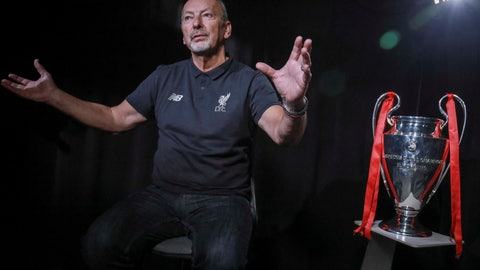 <p>               Liverpool soccer chief executive officer Peter Moore gestures during an interview Wednesday, July 24, 2019, in New York. At right is the 2019 Champions League championship trophy. (AP Photo/Bebeto Matthews)             </p>