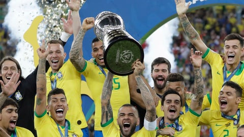 <p>               Brazil's Dani Alves lifts up his team's trophy after winning the final soccer match of the Copa America against Peru at Maracana stadium in Rio de Janeiro, Brazil, Sunday, July 7, 2019. Brazil won 3-1. (AP Photo/Andre Penner)             </p>