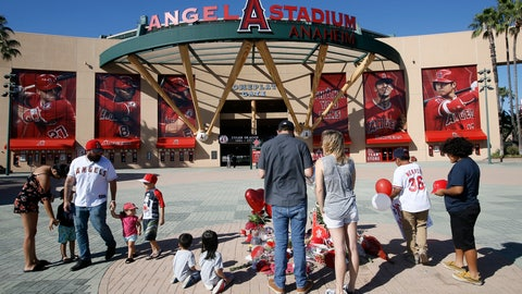 <p>               Mourners stand at a memorial to give their condolences for Los Angeles Angels pitcher Tyler Skaggs at Angel Stadium in Anaheim, Calif., Monday, July 1, 2019. Skaggs died at the age of 27, stunning Major League Baseball and leading to the postponement of the team's game against the Texas Rangers on Monday. (AP Photo/Alex Gallardo)             </p>
