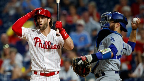 <p>               Philadelphia Phillies' Bryce Harper, left, reacts after striking out against Los Angeles Dodgers relief pitcher Julio Urias during the fourth inning of a baseball game Wednesday, July 17, 2019, in Philadelphia. At right is catcher Russell Martin. (AP Photo/Matt Slocum)             </p>