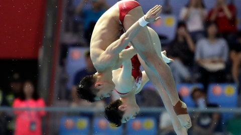 <p>               China's Lian Junjie and Si Yajie compete during the mixed's 10m synchro platform final competitions at the World Swimming Championships in Gwangju, South Korea, Saturday, July 13, 2019. (AP Photo/Lee Jin-man)             </p>