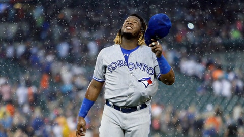 <p>               Toronto Blue Jays' Vladimir Guerrero Jr., with his glove tucked inside his uniform, walks off the field after a rain delay was called during the fourth inning of a baseball game against the Detroit Tigers, Saturday, July 20, 2019, in Detroit. (AP Photo/Duane Burleson)             </p>