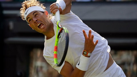 <p>               Spain's Rafael Nadal serves to Japan's Sugita Yuichi in a singles match during day two of the Wimbledon Tennis Championships in London, Tuesday, July 2, 2019. (AP Photo/Kirsty Wigglesworth)             </p>