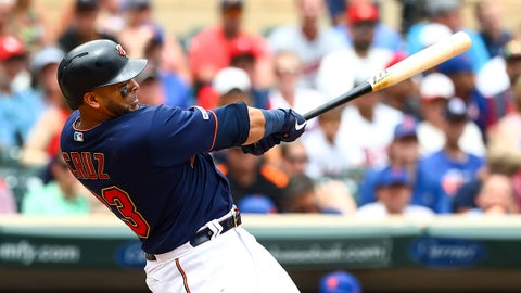 Jul 17, 2019; Minneapolis, MN, USA; Minnesota Twins designated hitter Nelson Cruz (23) hits a solo home run against the New York Mets in the third inning at Target Field. Mandatory Credit: David Berding-USA TODAY Sports