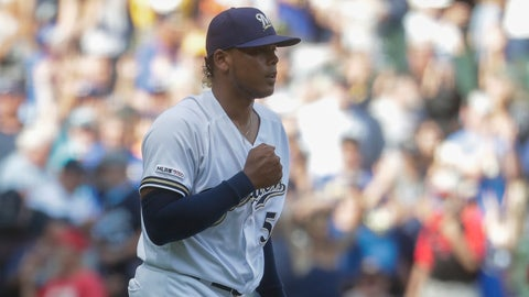 Milwaukee Brewers relief pitcher Freddy Peralta reacts after the final out of a baseball game against the Cincinnati Reds Wednesday, July 24, 2019, in Milwaukee. The Brewers won 5-4. (AP Photo/Morry Gash)