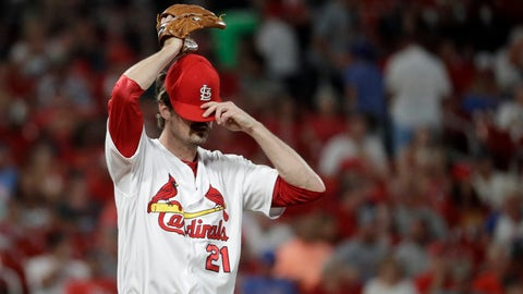 St. Louis Cardinals relief pitcher Andrew Miller adjusts his cap after giving up a solo home run to Arizona Diamondbacks' Jake Lamb during the seventh inning of a baseball game Friday, July 12, 2019, in St. Louis. (AP Photo/Jeff Roberson)