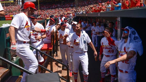 Jul 14, 2019; St. Louis, MO, USA; St. Louis Cardinals first baseman Paul Goldschmidt (46) is congratulated by teammates after hitting a 2 run home run against the Arizona Diamondbacks during the third inning at Busch Stadium. Mandatory Credit: Joe Puetz-USA TODAY Sports