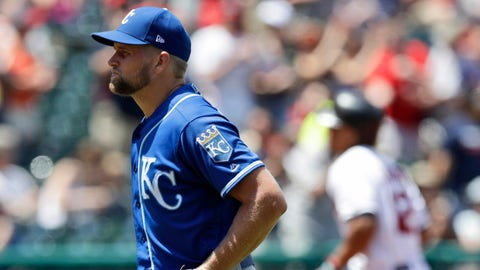 Kansas City Royals starting pitcher Glenn Sparkman, left, waits for Cleveland Indians' Francisco Lindor to run the bases after Lindor hit a two-run home run in the third inning of a baseball game, Sunday, July 21, 2019, in Cleveland. (AP Photo/Tony Dejak)