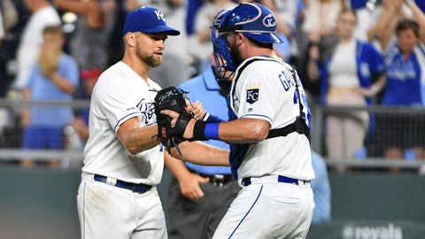 Jul 16, 2019; Kansas City, MO, USA; Kansas City Royals starting pitcher Glenn Sparkman (57) is congratulated by catcher Cam Gallagher (36) after the win over the Chicago White Sox at Kauffman Stadium. Sparkman pitched a complete game shut-out. Mandatory Credit: Denny Medley-USA TODAY Sports