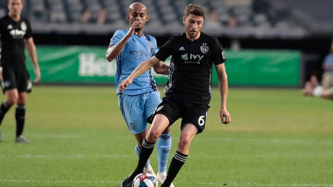 Jul 26, 2019; New York, NY, USA; Sporting Kansas City midfielder Ilie Sanchez (6) controls the ball as New York City FC forward Heber (9) defends during the first half at Yankee Stadium. Mandatory Credit: Vincent Carchietta-USA TODAY Sports