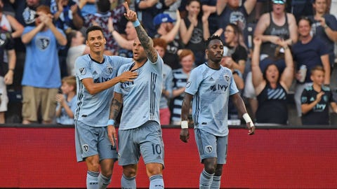 Jul 6, 2019; Kansas City, KS, USA; Sporting Kansas City midfielder Yohan Croizet (10) reacts after scoring a goal during the first half against the Chicago Fire at Children's Mercy Park. Mandatory Credit: Peter G. Aiken/USA TODAY Sports