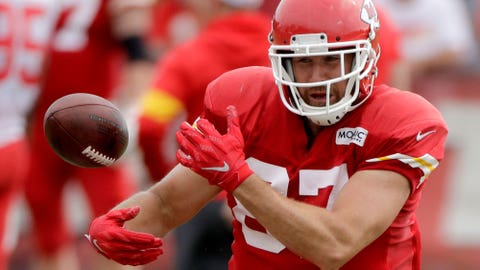 Kansas City Chiefs tight end Travis Kelce tries to catch a ball during NFL football training camp Friday, Aug. 2, 2019, in St. Joseph, Mo. (AP Photo/Charlie Riedel)