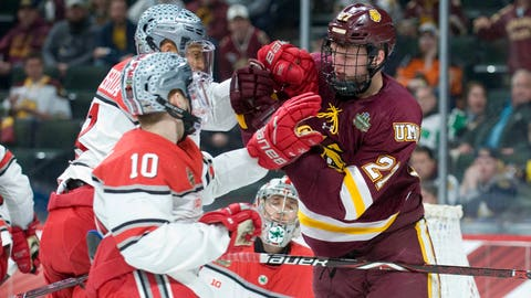 Apr 5, 2018; St. Paul, MN, USA; Ohio State forward Dakota Joshua (8) and Minnesota Duluth Bulldogs forward Riley Tufte (27) push and shove next to the Ohio State net during the second period in the 2018 Frozen Four college hockey national semifinals at Xcel Energy Center. Mandatory Credit: Marilyn Indahl-USA TODAY Sports