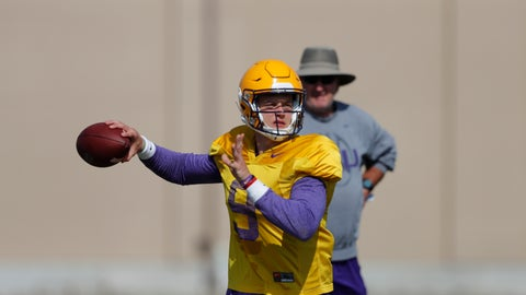 <p>               LSU quarterback Joe Burrow (9) works out during their NCAA college football practice in Baton Rouge, La., Wednesday, Aug. 7, 2019. (AP Photo/Gerald Herbert)             </p>