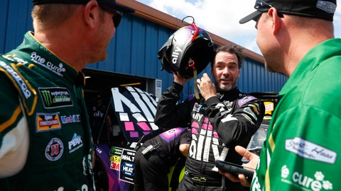<p>               Jimmie Johnson, center, talks with Clint Bowyer, left, during practice for a NASCAR Cup Series auto race at Michigan International Speedway in Brooklyn, Mich., Saturday, Aug. 10, 2019. (AP Photo/Paul Sancya)             </p>