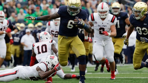 <p>               FILE - In this Sept. 8, 2018, file photo, Notre Dame running back Tony Jones Jr (6), runs in a touchdown against Ball State during the first half of an NCAA college football game in South Bend, Ind. There is no Dexter Williams in the backfield this season for No. 9 Notre Dame. Instead, the Fighting Irish will look to a stable of running backs to pick up the slack, including Tony Jones and converted wide receiver Jafar Armstrong. (AP Photo/Nam Y. Huh, File)             </p>