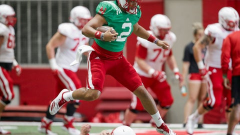 <p>               In this photo taken Aug. 7, 2019, Nebraska quarterback Adrian Martinez (2) leaps over a player during NCAA college football preseason practice in Lincoln, Neb. Martinez, the most productive freshman quarterback in the nation last season, averaged 371 yards of total offense against West Division opponents and 295 overall. He led an offense that ranked second in the Big Ten and scored 30 points per game. (AP Photo/Nati Harnik)             </p>