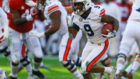 <p>               FILE - In this Saturday, Nov. 24, 2018 file photo, Auburn running back Kam Martin (9) carries the ball against Alabama during the first half of an NCAA college football game in Tuscaloosa, Ala. College football starts better than it ends. The sport has evolved through numerous postseason systems that have clumsily crowned champions, and while the College Football Playoff does a better job than its predecessors it has also spawned a month's worth of tedious debate over the meaningfulness of bowl games. (AP Photo/Butch Dill, File)             </p>