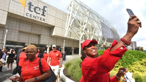 <p>               Gina Peoples, right, of Detroit, a volunteer with The Parade Company, takes a selfie in front of the newly named TCF Center in downtown Detroit Tuesday, Aug. 27, 2019. Politicians, executives and VIPs gathered at what had been known as Cobo Center since 1960 for the renaming announcement. (Todd McInturf /Detroit News via AP)             </p>