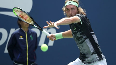 <p>               Stefanos Tsitsipas, of Greece, returns a shot to Andrey Rublev, of Russia, during the first round of the US Open tennis tournament Tuesday, Aug. 27, 2019, in New York. (AP Photo/Kevin Hagen)             </p>