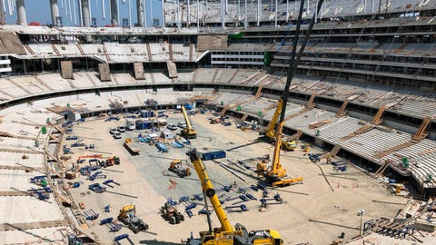 <p>               Construction workers continue work in the bowl of the NFL stadium rising in Inglewood, Calif., Tuesday, July 30, 2019. The multi-billion-dollar complex is on schedule to open in July 2020. Officials from the NFL, the Los Angeles Rams and the Los Angeles Chargers toured the stadium as part of early preparations for the Super Bowl in February 2022. (AP Photo/Greg Beacham)             </p>