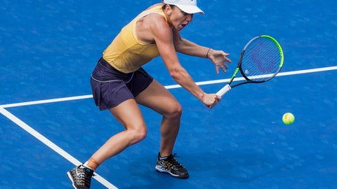 <p>               Simona Halep is a Romania returns a shot to Jennifer Brady of the US during round 2 of the Rogers Cup Women's tennis tournament in Toronto, Wednesday, Aug. 7, 2019. (Mark Blinch/The Canadian Press via AP)             </p>