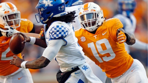 <p>               FILE - In this Nov. 10, 2018, file photo, Kentucky quarterback Terry Wilson (3) is pressured by Tennessee linebacker Darrell Taylor (19) in the first half of an NCAA college football game in Knoxville, Tenn. Darrell Taylor is coming off a breakthrough season but believes he's capable of doing even better. Taylor recorded eight sacks last year, the most of any Southeastern Conference player who's back this fall. (AP Photo/Wade Payne, File)             </p>